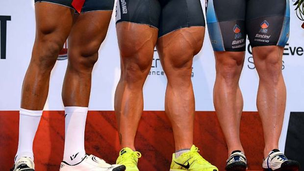 Thunder thighs: Robert Forstemann of Germany (centre) stands alongside Nicholas Njisane of Trinidad (left) and Shane Perkins.