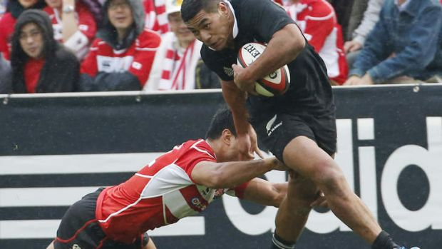 Charles Piutau of the All Blacks is tackled by Shota Horie of Japan.