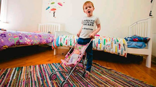 Four-year-old Archie is happy pushing around a pink pram, just as his brother and sister were when they were toddlers. ...