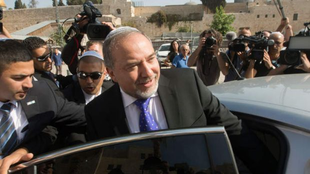 Former Israeli Foreign Minister Avigdor Lieberman enters his car after visiting the Western Wall following the verdict ...