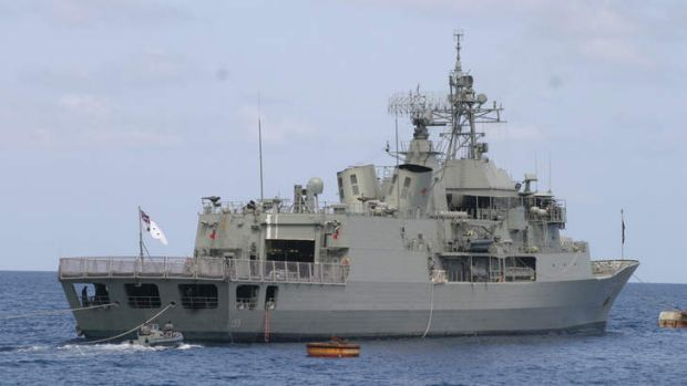The HMAS Ballarat tried to turn a boat carrying 56 suspected asylum seekers back to Indonesia before the wooden vessel's ...