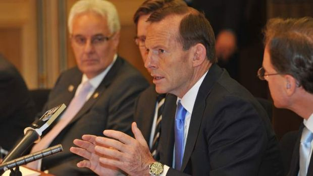 Prime Minister Tony Abbott at a roundtable discussion on the carbon tax with business leaders on Friday.