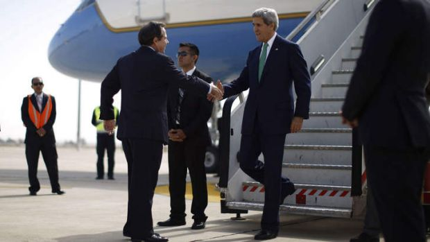Wherever, whenever: US ambassador Stuart Jones greets John Kerry as he arrives in Amman. Mr Kerry's aides say he is ...