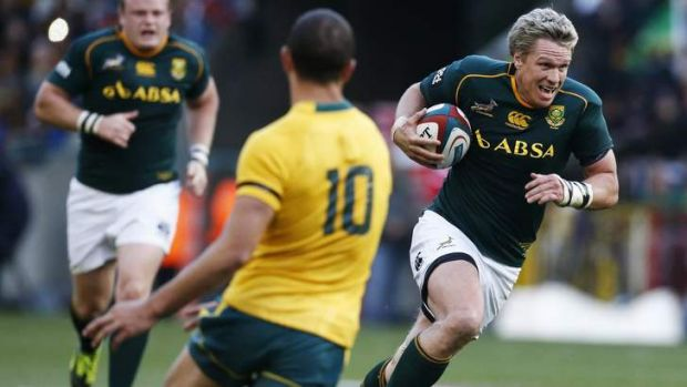 Jean de Villiers makes a break against the Wallabies earlier this year.