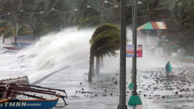 Waves pounding the sea wall during Typhoon Haiyan.