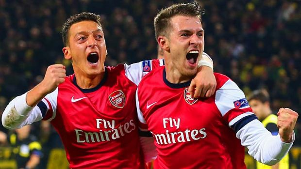 Top form: Arsenal's Aaron Ramsey, right, celebrates with Mesut Ozil after scoring against Borussia Dortmund midweek in ...