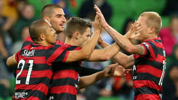 Great start: Wanderers teammates congratulate Shannon Cole on scoring against Melbourne Heart on Friday.