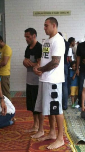 Blake Ferguson prays with his mentor and second cousin Anthony Mundine in Zetland on Friday.