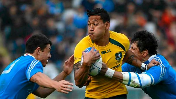 A handful: Israel Folau tested the Italian defence.