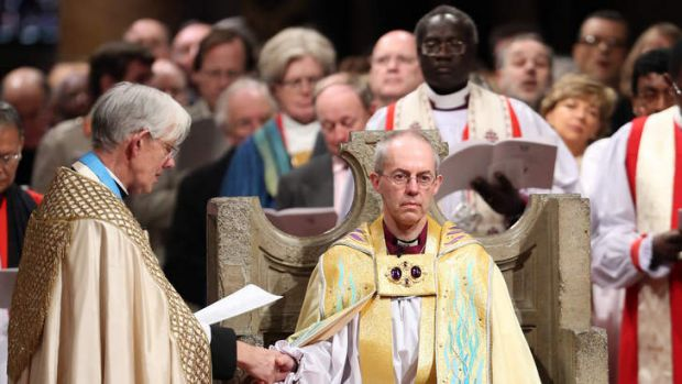 The Most Reverend Justin Welby sits in the Chair of St Augustine during his enthronement as the Archbishop of Canterbury.