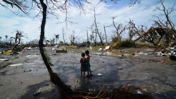 Two boys take in the devastation wreaked by typhoon Haiyan in Tacloban.