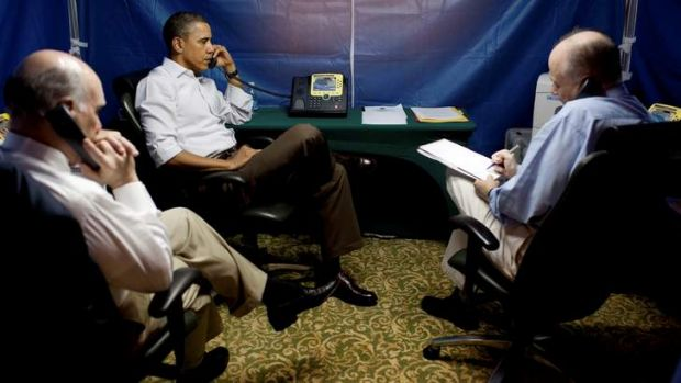 President Barack Obama is briefed on the uprising in Libya during a conference call inside a secure tent setup near his ...