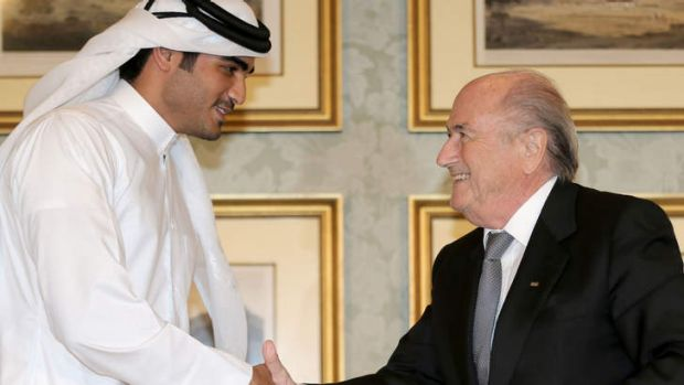Chairman of the Qatar 2022 bid committee Sheikh Mohammed bin Hamad al-Thani shakes hands with FIFA president Sepp ...