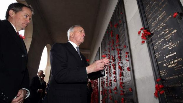 Opposition Leader Bill Shorten and former prime minister Paul Keating place a poppy after the Remembrance Day Ceremony ...