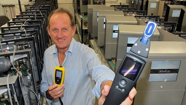 Alcolizer chief executive Gary Johnson with one of their breathalyser's (yellow) and the new unit that can test both ...