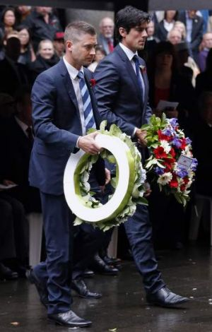 Michael Clarke and Alastair Cook prepare to lay wreaths during a Remembrance Day ceremony in Sydney on Monday.