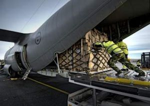 Staff load a Hercules aeroplane with relief equipment at Orebro airport in central Sweden to support the UN disaster ...