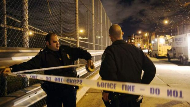 New York Police Department officers mark off the area surrounding the scene of a multiple shooting crime scene on Maujer ...
