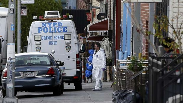 Crime scene personnel in Brooklyn, where a musician shot and killed two members of an Iranian indie rock band, the ...