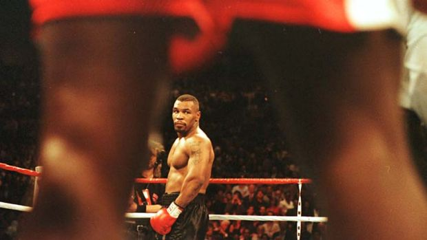 Mike Tyson looks across the ring at Frank Bruno ahead of their fight in March 1986.