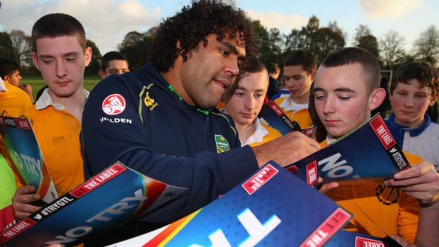 Sam Thaiday  signs autographs in Manchester.