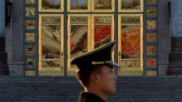 A Chinese para-military police standing guard beside the Great Hall of the People after the Communist Party Central ...