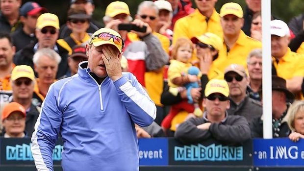 Jarrod Lyle, watched by a huge gallery, is overcome by emotion before his first shot on the first tee.