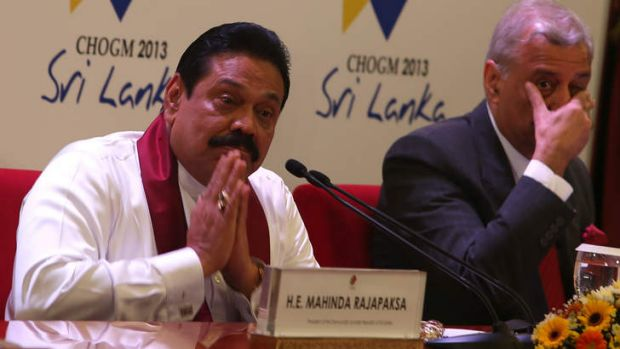 On the defensive: Sri Lankan President Mahinda Rajapakse greets journalists at his news conference with Commonwealth ...