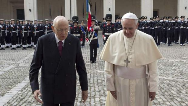 """Threat from the """"godfathers"""":  Pope Francis is greeted by Italy's President Giorgio Napolitano as he arrives for a ..."""