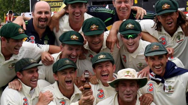 When they were kings: John Buchanan (in the back row) celebrates with the Australian team after reclaiming the Ashes in 2006.