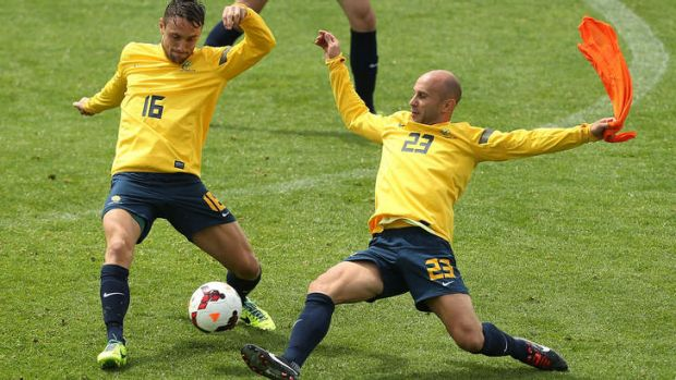 Big penalty: Mark Bresciano challenges during a Socceroos training session on Saturday.