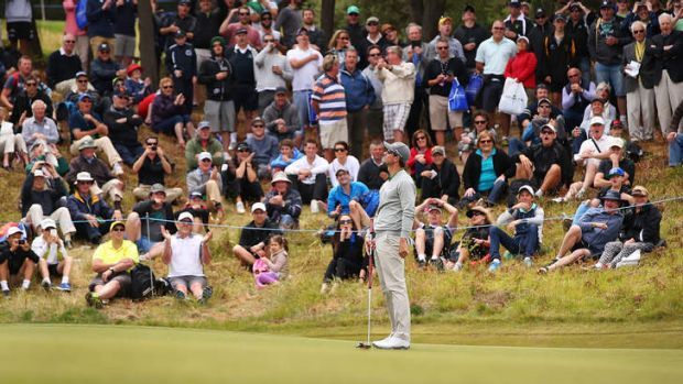 Adam Scott shows his disappointment at missed putt.