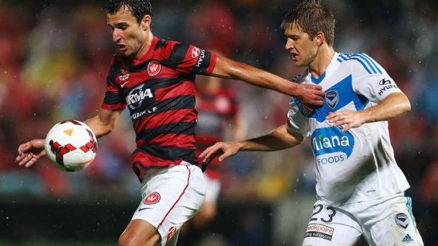 Labinot Haliti of the Wanderers is challenged by Adrian Leijer of the Victory.