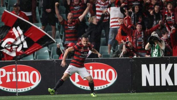 Top of the heap: Mark Bridge celebrates a goal at home against the Melbourne Victory on Saturday night.