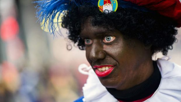 A woman dressed as Zwarte Piet (Black Piet) takes part in the Sinterklaas festival in the Netherlands.