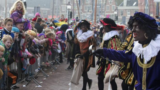 "The Dutch version of Santa Claus, Sinterklaas, or Saint Nicholas, and his blackface sidekicks ""Zwarte Piet"" or ""Black ..."