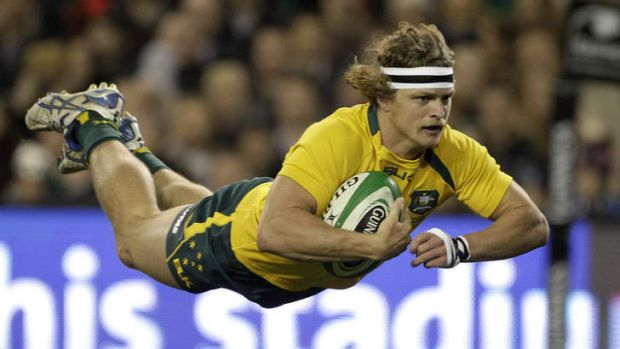 His try: Nick Cummins crosses in the Wallabies' 32-15 win against Ireland in Dublin on Saturday.