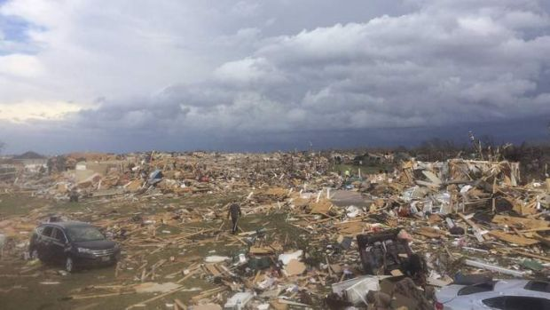 Extensive damage is pictured in the aftermath of a tornado that touched down in Washington, Illinois in this photo ...