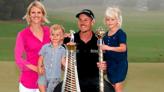 Rich pickings: Henrik Stenson with his family on the 18th green after winning the Race to Dubai.