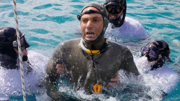 Nicholas Mevoli is helped after a free dive on Friday. On Sunday, he died after spending 3 minutes 38 seconds under water.
