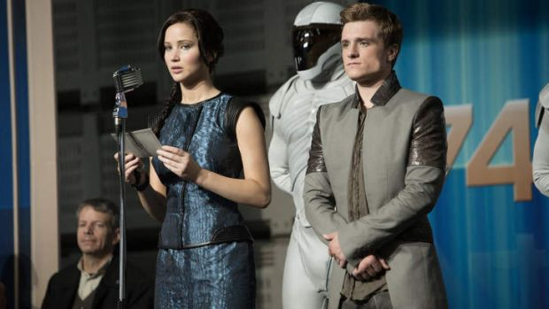 Deadly publicity tour: Katniss Everdeen (Jennifer Lawrence) and Peeta Mellark (Josh Hutcherson) become symbols of a ...