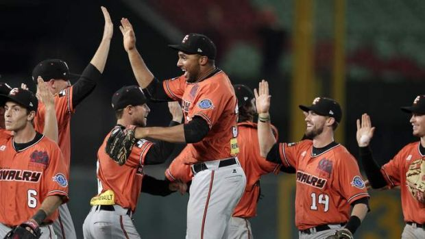 Players of Australia's Canberra Cavalry celebrate after defeating South Korea's Samsung Lions 9-5 during the semi-final ...