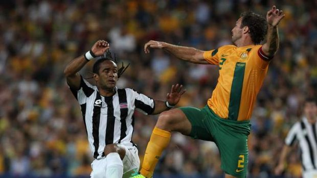 Socceroos captain Lucas Neill rises to the challenge.