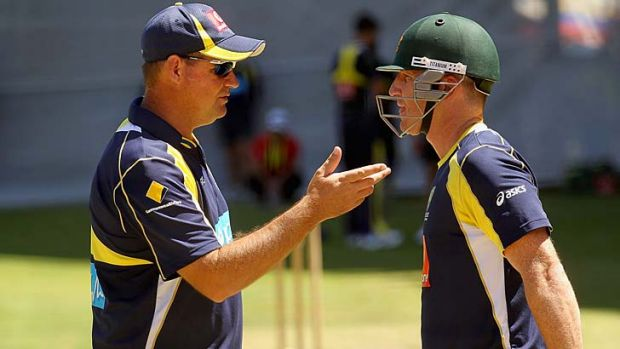 Brad Haddin (R) speaks to coach Micky Arthur while batting during an Australian nets session at Adelaide Oval in January ...