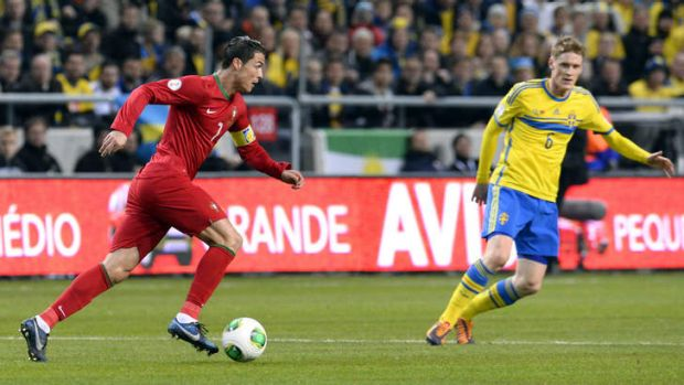 Solo performance: Cristiano Ronaldo terrorises the Sweden defence last week.