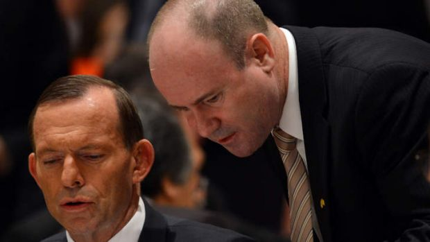 Australian Ambassador Greg Moriarty, pictured with Prime Minister Tony Abbott, was called in for a meeting with ...
