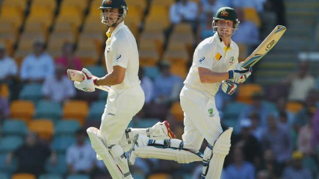 Rescue mission: Brad Haddin and Mitchell Johnson of Australia run between the wickets.