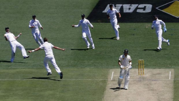 On his way: Stuart Broad charges towards teammates after dismissing Michael Clarke for one just after lunch.