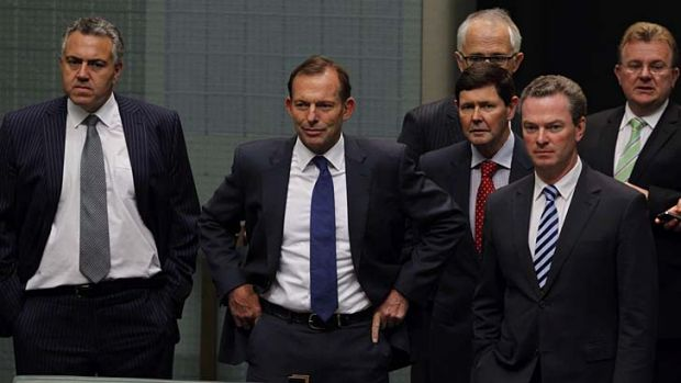 A step closer: Prime Minister Tony Abbott with members of the Coalition at Parliament House, Canberra, on Thursday.