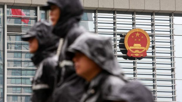 Public security personnel guard the Hefei Municiple Intermediary People's Court in Hefei, Anhui Province, China.